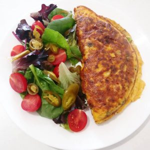Omelette filled with cherry tomatoes, beans, spring onions & mushrooms